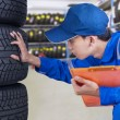 Mechanic person examining tires — Stock Photo #68175595