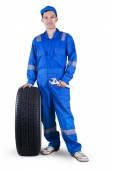 Friendly mechanic with a tire and wrench — Photo