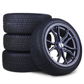 Four racing tires isolated — Stock Photo
