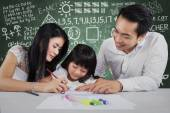 Happy family learn to write — Stock Photo
