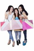 Group of happy teenage girls after shopping — Stock Photo
