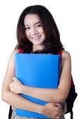 Gorgeous teenage girl with bag and folder — Stock Photo