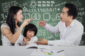 Little girl with two parents quarreling — Stock Photo