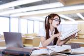 Pensive student reading a book in class — Stock Photo