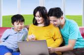 Pregnant woman with son and husband — Stock Photo