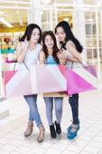 Young shoppers looking shopping bag — Stock Photo