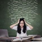 Anxious girl preparing for exam — Stock Photo #68741653