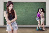 Sad girl mocked by her friends — Stock Photo