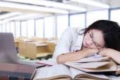 Exhausted teenage girl sleeping in class — Stock Photo