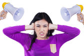 Girl bullied with two megaphone — Stock Photo