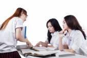 Team of students doing school task — Stock Photo