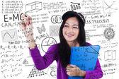 Teenage student makes math formula — Stock Photo