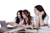 Three student studying on desk — Stock Photo