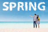 Couple with cloud shaped a spring text — Stock Photo