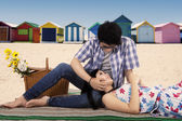 Man fondle his girlfriend at beach — Stock Photo
