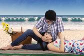 Romantic chinese couple at coast — Stock Photo