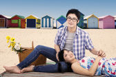 Two young couple picnic at beach — Stock Photo