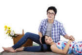 Young couple sitting on mat at studio — Stock Photo