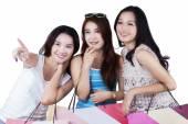 Beautiful teenage girls with shopping bags — Stock Photo