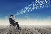 Businessman on wheelchair sending information — Stock Photo