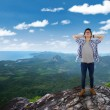 Happy man relaxing at the mountain — Stock Photo #71337705