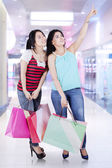 Two female shoppers in mall — Stock Photo