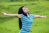 Pretty woman breathe fresh air at field — Stock Photo