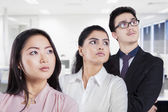 Multiracial business team looking at copyspace — Stock Photo