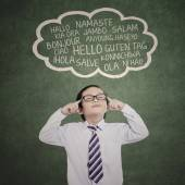 Male student studying multilanguage 1 — Stock Photo