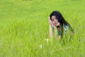 Lovely woman daydreaming at field — Stock Photo
