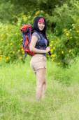 Female hiker smiling at the camera — Stock Photo
