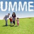 Family enjoy vacation at green meadow — Stock Photo #71952011