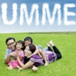Asian parents lay at field with their children — Stock Photo #71957713