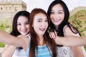 Group of teenage girls taking a selfie — Stock Photo