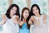 Group of teenage girls holding a blank board — Stock Photo