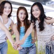 High school students joining hands — Stock Photo #72426781