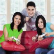 Young people playing games at home — Stock Photo #72428241