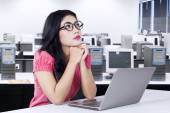 Pensive worker sitting in the office room — Stock Photo