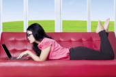 Woman surfing on internet at home — Stock Photo