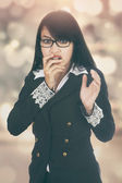 Scared businesswoman with bokeh background — Stock Photo