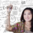 Girl writes math and science formula — Stock Photo #75255561