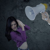 Girl scolded with a megaphone — Stock Photo
