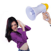 Scared girl scolded with a megaphone — Stock Photo