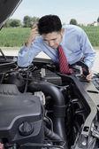 Worried man look at his broken car — Stock Photo