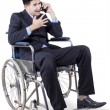 Disabled businessperson looks angry on the phone — Stock Photo #75825009