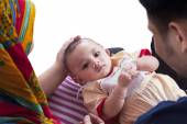 Cute baby with parents look at the camera — Stock Photo