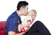 Dad kiss the lips of baby — Stock Photo