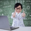 Kid with laptop shows OK sign — Stock Photo #76602415