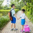 Two siblings going to school together — Stock Photo #76606409