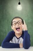 Cheerful little boy under lamp — Stock Photo